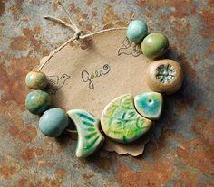 Gaea Ceramic Bead and Art Studio Blog - Ocean blue and green sectional fish ceramic bead set - gaea.cc