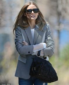 Olivia Palermo wearing ripped skinny jeans paired with a hounds' tooth blazer