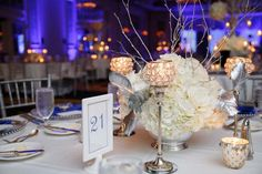 white and silver floral centerpiece decor  - Loews Portofino Bay Wedding - Orlando Wedding - Photo: Victoria Angela Photography - Orange Blossom Bride