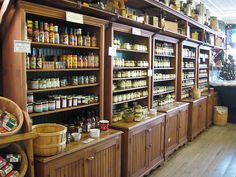 Open shelves, a high shelf running along the ceiling for larger display items, bushel baskets. Great for a kitchen, too. Photo by Eastlake Victorian.