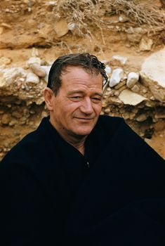 John Wayne.  What a fabulous picture, does anyone know where it is from?