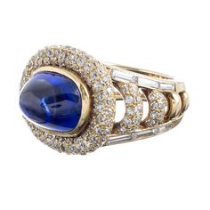 Van Cleef & Arpels Cabochon Sapphire Ring  | From a unique collection of vintage cluster rings at https://www.1stdibs.com/jewelry/rings/cluster-rings/