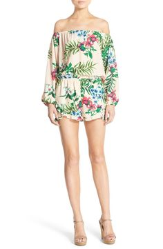 Falling for the bold, tropical flowers that perfectly balance the free-spirited sensibility of this off-the-shoulder romper.