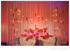 purple and orange wedding reception | indian_wedding_pink_red_orange_roses_purple_orange_pink_lights_candles ...