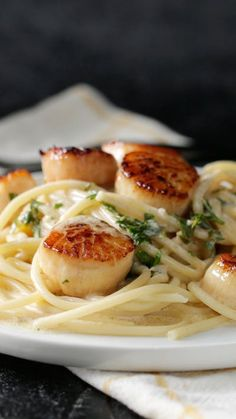 Garlic Butter Scallops Save Print Prep time 5 mins Cook time 15 mins Total time 20 mins Rich and creamy garlic butter scallops on pasta… delightfully decadent! Recipe type: Dinner Ingredients pounds s Source by gvanbrabant Fish Recipes, Seafood Recipes, Pasta Recipes, Dinner Recipes, Cooking Recipes, Healthy Recipes, Cooking Tv, Cooking Ribs, Beef Recipes