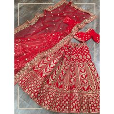 Red velvet heavy embroidered bridal lehenga choli