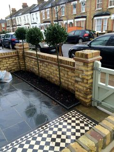A complete design project for this London Front Garden paids Victorian mosaic tiling with contemporary paving. With the addition of a new front gate, yellow brick wall and planting - for a complete makeover. Victorian Front Garden, Victorian Terrace House, Edwardian House, Victorian Gardens, Modern Victorian Houses, 1930s House, Front Garden Path, Front Path, Garden Paths