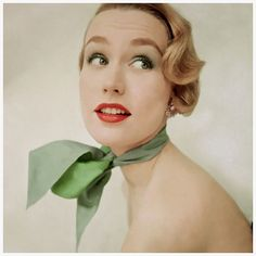 Photo Clifford Coffin 1951.   For July 1951 Glamour. A model wears blue-green eye shadow and matching mascara. Her reversible silk shantung scarf is the same shade of blue-green