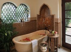 Moroccan patterns meet Spanish Colonial style in this lavish bathroom [Design: PavoReal Interiors]