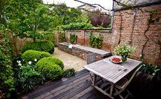 Archi-Verde Antwerp urban walled garden deck outdoor string lights; Gardenista