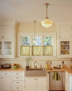 sink, soffit-free tall cabinets, nice windows by sink