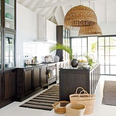 west indies style kitchen with black mahogany cabinets and woven pendants