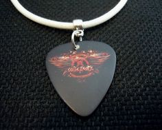 Aerosmith Guitar Pick on Rolled White Leather Cord Necklace by ItsYourPick on Etsy