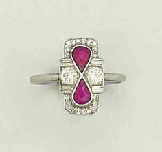 An art deco ruby and diamond ring   Vertically set, each pear-shaped, mixed-cut ruby, within a geometric surround of baguette, single and brilliant-cut diamond detail, circa 1925