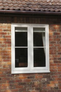 Timber flush casement window finished in Cream