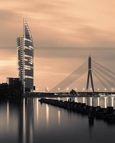 Two modern symbols of Riga - a building of Swedbank and Vansu bridge, Latvia Copyright: Oleg Tiunchik Places To Travel, Places To Visit, City Break, Travel Pictures, Tourism, Beautiful Places, Scenery, Sun Stone, Europe Destinations