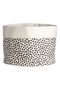 Bread basket in woven cotton fabric with a printed pattern. Foldover edge at top. Diameter 7 in. height 5 in. Textiles, Bread Bags, H&m Home, Black Spot, H&m Online, Decor Interior Design, Home Buying, Cotton Fabric, Woven Cotton