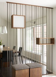 modern dining room wall... without the shelves. Great way to divide room