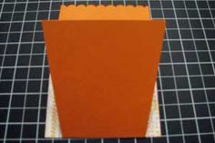 """Flower Pot Card - Step 5  Adhere the 3"""" x 3 ½"""" piece of patterned paper to the bottom front of the flower pot. Next - Flip the flower pot over and trim away the excess patterned paper from each side.   ...  Read more: http://www.splitcoaststampers.com/resources/tutorials/flowerpotpocket/"""