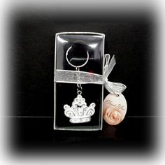 "Crown Key Chain | Nuptial Knick Knacks    A perfect addition to any royal themed wedding, party or event, Our Crown Key Chain is made of poly resin with rhinestone accents and measures 1 3/4"". Each key chain comes packaged in a clear acetate box with ribbon."