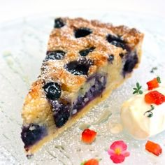 Blueberry & Almond Tart - A beautiful tart with a gluten free frangipane cream, accented with creme fraiche, berries & micro herbs.