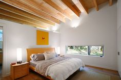 Bedroom with exposed beams in Washington state.