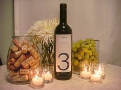 DIY Wine Bottle Centerpieces Grab some spraypaint, empty wine bottles, candles, and flowers and you have a super cute and easy DIY centerpiece for your next party! Wine Bottle Centerpieces, Wedding Centerpieces, Wedding Table, Diy Wedding, Wine Bottles, Shower Centerpieces, Centerpiece Ideas, Wine Corks, Wedding Ideas