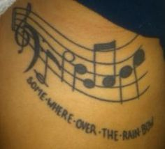 Somewhere over the rainbow tattoo - but with rainbow colors and no lyrics.