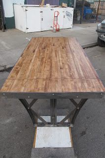 Dining table made from Maple slab of salvaged bowling lane stock. The legs are made from steel lintels found at urban ore Bryan Appleton Designs http://bryanappletondesigns.com/