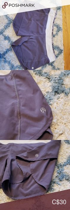 Lululemon running short Lululemon running short in grey with white accents. There is a pull tie at the waist and back zipper pocket. lululemon athletica Shorts
