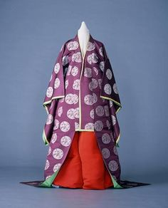 "Keiko (袿袴), The ""Keiko"" was established in 1885 (Meiji 17). It is used by holding the noblewoman to attend the various ceremonies of the court. It includes a ""Uchiki"" (outerwear, 袿), associated with a ""kiribakama"" (hakama skirt, 切袴). The ""Uchiki"" is purple and has circular woven patterns of white plum blossoms. When wearing the ""keiko"", we put shoes made of the same material as the kiribakama."