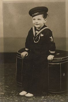 early 1900s photo of a cute little boy in a U.S. Navy sailor outfit. ... can this little boy be any cuter?!? vintage childrens sailor suit and hat with spiffy white dress shoes.