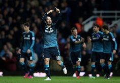 Eden Hazard Photos - Eden Hazard of Chelsea celebrates after scoring the opening goal during the Barclays Premier League match between West Ham and Chelsea at the Boleyn Ground on March 4, 2015 in London, England. - West Ham United v Chelsea