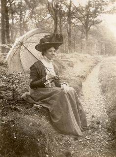 Lady with umbrella , c 1900