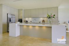 White overhead cupboards, grey glass splash back, white shimmer stone bench top, Formica brushed pewter all lower cupboards and island front Stone Bench, Grey Glass, Splashback, House Colors, Kitchen Cabinets, Cupboards, Home Kitchens, New Homes, Inspiration