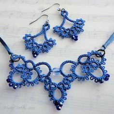Blue tatted necklace and earrings The lost art of shuttle tatting has been found! Marilee Rockley guides you through the steps of this delicate craft, from basic to advanced. Tatting Necklace, Lace Bracelet, Tatting Jewelry, Tatting Lace, Crochet Necklace, Lace Patterns, Jewelry Patterns, Canvas Patterns, Needle Tatting Patterns