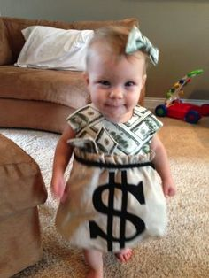 Toddler as a bag of money! >super idea for the 8-10 year olds to wear for 'if I had a million dollars' :)  Girls in those gold skirts with the dollar on them; boys should fit the gold pants. >just have to add $ signs to front of skirts & top of legs + make money fabric shirts &  hair bows