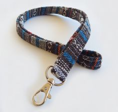 Woven Lanyard / Boho Keychain / Indian Blanket Inspired / Bohemian / Key Lanyard / Turquoise / Woven Stripe Fabric / ID Badge Holder Gorgeous Indian blanket style prints striped deep turquoise, orange, brown, and other warm bohemian colors adorn these lanyards. This listing is for two color variations - one in teal (first pictured) and one primarily brown (second pictured). The boho lanyards come with 2 attachment options - a sturdy swivel clasp which can e...