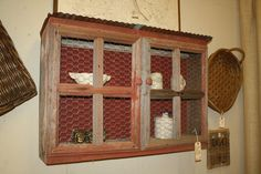 Adorable cabinet from barn wood, roofing tin, and chicken wire.  Ive got all these materials, have to hit up the hubby :)