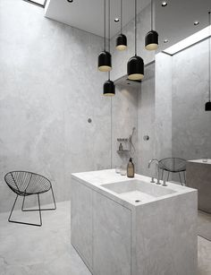 "Although this bathroom is too severe and minimal for me I do love the unconventional layout... vanity positioned in centre of room with decorative lighting above... and a mirrored wall rather than the cliche mirror positioned centrally over vanity... ""the unexpected"", it never fails in interior styling!"