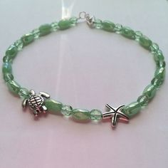 "Pretty Green Adventurine  Ankle Bracelet Nice Green Beaded Ankle Bracelet! This has both a Turtle and a Starfish. Be ready for the beach! Anklet measures 11"" Handmade Jewelry Bracelets"