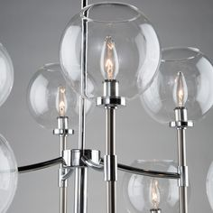 "Inspired by designer and TV host Steven Sabados of S&C, Artcraft's ""Hamilton"" collection is classic in design. It has tubular arms, center column and rods. The glassware is clear and round. Ponder using frosted globe bulbs for a mid century modern appeal.  Shown in the plated two tone version - chrome and brushed nickel. (Also available in satin brass).  Choose from mini pendants, chandeliers and sconces. Pendant Chandelier, Chandelier Lighting, Chandeliers, Dinning Lighting, Brushed Nickel, Bulbs, Hamilton, Home Furnishings, Mid-century Modern"
