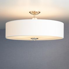 Built to hold six lights, the Bankloft Semi-Flush-Mount Ceiling Fixture will effectively illuminate any living or dining room. The fabric drum shade and frosted-glass bottom create a soft glow to keep your space well-lit and stylish. Featuring accents mad