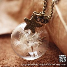 Here you find a new design for our popular jewelry with real dandelion.  As it is a natural product, each necklace is unique and makes an