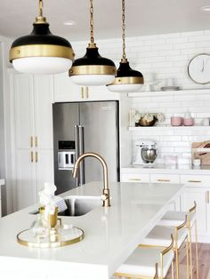 whitelanedeco Feiss Candence Pendant brass black and white kitchen Delta Trinsic Faucet open shelving with subway tile brass par pull and with white cabinets Fuji gold ba. Home Decor Kitchen, Interior Design Kitchen, Kitchen Ideas, Kitchen Pictures, Kitchen Designs, Gold Home Decor, White Kitchen Decor, Kitchen Images, Decorating Kitchen