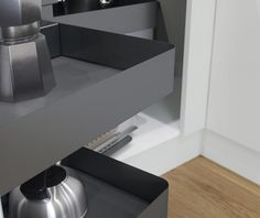 Optimised blind corner storage in a cool powder coated steel look User friendly movement makes for easy access upon opening As door opens, front basket swing sideways, automatically granting access to rear baskets
