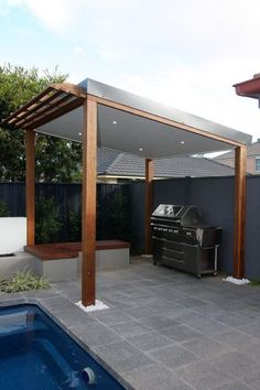 30 Grill Gazebo Ideas to Fire Up Your Summer Barbecues The solid roof of this grill gazebo has a small pergola style overhang near the pool edge, and features an L shaped wooden bench to one side. Pool Gazebo, Grill Gazebo, Backyard Pergola, Pergola Kits, Gazebo Ideas, Diy Gazebo, Patio Ideas, Rooftop Pool, Large Backyard