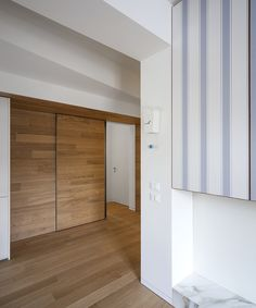 View the full picture gallery of Elda Wooden Wardrobe, Mirrored Wardrobe, Movable Walls, Striped Wallpaper, Kitchen Living, Contemporary Architecture, Second Floor, Sliding Doors, Living Area