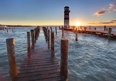 Wall Mural Lighthouse at Lake Neusiedl at sunset Harbor Town, Broken Images, Getting Up Early, Days Of The Year, Montage, Outdoor Sofa, Mother Nature, Lighthouse, Wall Murals