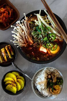 A hot and bubbling spicy kimchi tofu stew made with a seafood broth chocked full of pork and shrimp. Comfort food, right there.